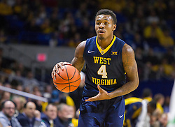 Dec 17, 2015; Charleston, WV, USA; West Virginia Mountaineers guard Daxter Miles Jr. (4) looks to pass the ball during the first half against the Marshall Thundering Herd at the Charleston Civic Center . Mandatory Credit: Ben Queen-USA TODAY Sports