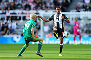 Isaac Hayden (#14) of Newcastle United plays a pass during the Premier League match between Newcastle United and Watford at St. James's Park, Newcastle, England on 31 August 2019.