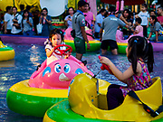 24 NOVEMBER 2018 - BANGKOK, THAILAND:  Children ride bumper boats on the midway at the Red Cross Fair. The Red Cross Fair is a fund raiser and an annual event in Bangkok that draws thousands of attendees every night of its nine day run. The fair features games of chance, a midway with rides, handicrafts and food. This is the first year the fair has been in Lumpini Park. Previously it had been held in the Dusit section of Bangkok. The 2018 Fair marks 125 years of service for the Red Cross in Thailand.    PHOTO BY JACK KURTZ