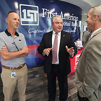 Tommy Chamblee, center, CEO of First American National Bank, talks with Joshua Brunt, right, and Greg Windham, at the bank's new branch on North Gloster Street in Tupelo prior to the ribbon cutting Friday afternoon.