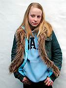Girl wearing a Gap jumper with a fur trimmed denim jacket