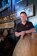 David Sharps, president of the Waterfront Museum, a museum and performance space located on Lehigh Vallery Barge no. 79. He is leaning on a wooden pattern for a propeller.