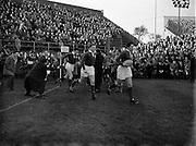 Irish Rugby Football Union, Ireland v Scotland, Five Nations, Landsdowne Road, Dublin, Ireland, Saturday 25th February, 1956,.25.2.1956, 2.25.1956,..Referee- H B Elliott, Rugby Football Union,..Score- Ireland 14 - 10 Scotland, ..Irish Team, ..P J Berkery, Wearing number 15 Irish jersey, Full back, Landsdowne Rugby Football Club, Dublin, Ireland,..W J Hewitt, Wearing number 14 Irish jersey, Right Wing, Instonians Rugby Football Club, Belfast, Northern Ireland,..N J Henderson, Wearing number 13 Irish jersey, Captain of the Irish team, Right centre, N.I.F.C, Rugby Football Club, Belfast, Northern Ireland,..A J O'Reilly, Wearing number 12 Irish jersey, Left Centre, Old Belvedere Rugby Football Club, Dublin, Ireland,  ..A C Pedlow, Wearing number 11 Irish jersey, Left Wing, Queens University Rugby Football Club, Belfast, Northern Ireland,..J W Kyle, Wearing number 10 Irish jersey, Outside Half, N.I.F.C, Rugby Football Club, Belfast, Northern Ireland,..J A O'Meara, Wearing number 9 Irish jersey, Scrum Half, Dolphin Rugby Football Club, Cork, Ireland, ..W B Fagan, Wearing number 1 Irish jersey, Forward, Wanderers Rugby Football Club, Dublin, Ireland, and, Moseley Rugby Football Club, Birmingham, England, ..R Roe, Wearing number 2 Irish jersey, Forward, London Irish Rugby Football Club, Surrey, England, and, Landsdowne Rugby Football Club, Dublin, Ireland,..B G Wood, Wearing number 3 Irish jersey, Forward, Garryowen Rugby Football Club, Limerick, Ireland, ..B N Guerin, Wearing  Number 4 Irish jersey, Forward, Bective Rangers Rugby Football Club, Dublin, Ireland, and, Galwegians Rugby Football Club, Galway, Ireland, ..L M Lynch, Wearing number 5 Irish jersey, Forward, Landsdowne Rugby Football Club, Dublin, Ireland, ..C T J Lydon, Wearing  Number 6 Irish jersey, Forward, Galwegians Rugby Football Club, Galway, Ireland, and, Monkstown Rugby Football Club, Dublin, Ireland, ..J R Kavanagh, Wearing number 7 Irish jersey, Forward, Wanderers Rugby Football Club, Dublin, Ireland, .