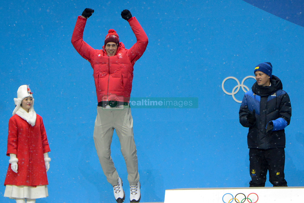 February 22, 2018 - Pyeongchang, South Korea - RAMON ZENHAEUSERN of Switzerland celebrates getting the silver medal in the Men's Slalom ski racing event in the PyeongChang Olympic Games. (Credit Image: © Christopher Levy via ZUMA Wire)