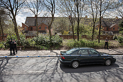 © Licensed to London News Pictures . 30/04/2013 . Salford , Greater Manchester , UK . A dark green Saab on the opposite side of the road to the prison van , sealed off with police tape . Police and forensic scenes of crime examiners at the scene on Regent Road , Salford , where a prison van was hijacked this morning (Tuesday 30th April) . Police report that two prisoners escaped . Photo credit : Joel Goodman/LNP