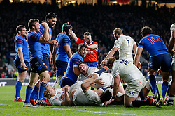 France replacement Rory Kockott celebrates after his side are awarded a penalty to keep England out in the dying moments of the game to deny them the try needed to win the Six Nation Championship - Photo mandatory by-line: Rogan Thomson/JMP - 07966 386802 - 21/03/2015 - SPORT - RUGBY UNION - London, England - Twickenham Stadium - England v France - 2015 RBS Six Nations Championship.