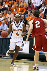 20 March 2010: Philana Greene brings the ball in, Alex Hoover defends. The Flying Dutch of Hope College fall to the Bears of Washington University 65-59 in the Championship Game of the Division 3 Women's NCAA Basketball Championship the at the Shirk Center at Illinois Wesleyan in Bloomington Illinois.