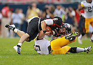 September 01 2012: Northern Illinois Huskies quarterback Jordan Lynch (6) is sacked by Iowa Hawkeyes defensive lineman Dominic Alvis (79) during the second half of the NCAA football game between the Iowa Hawkeyes and the Northern Illinois Huskies at Soldiers Field in Chicago, Illinois on Saturday September 1, 2012. Iowa defeated Northern Illinois 18-17.