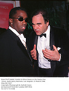 Sean 'Puff Daddy' Combs &amp; Oliver Stone at the Vanity Fair Oscar  night party, Mortons, Los Angeles. 23 March 1988. Film 98174f27<br />