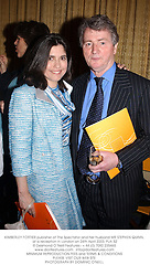 KIMBERLEY FORTIER publisher of The Spectator and her husband MR STEPHEN QUINN, at a reception in London on 24th April 2003.	PJA 52