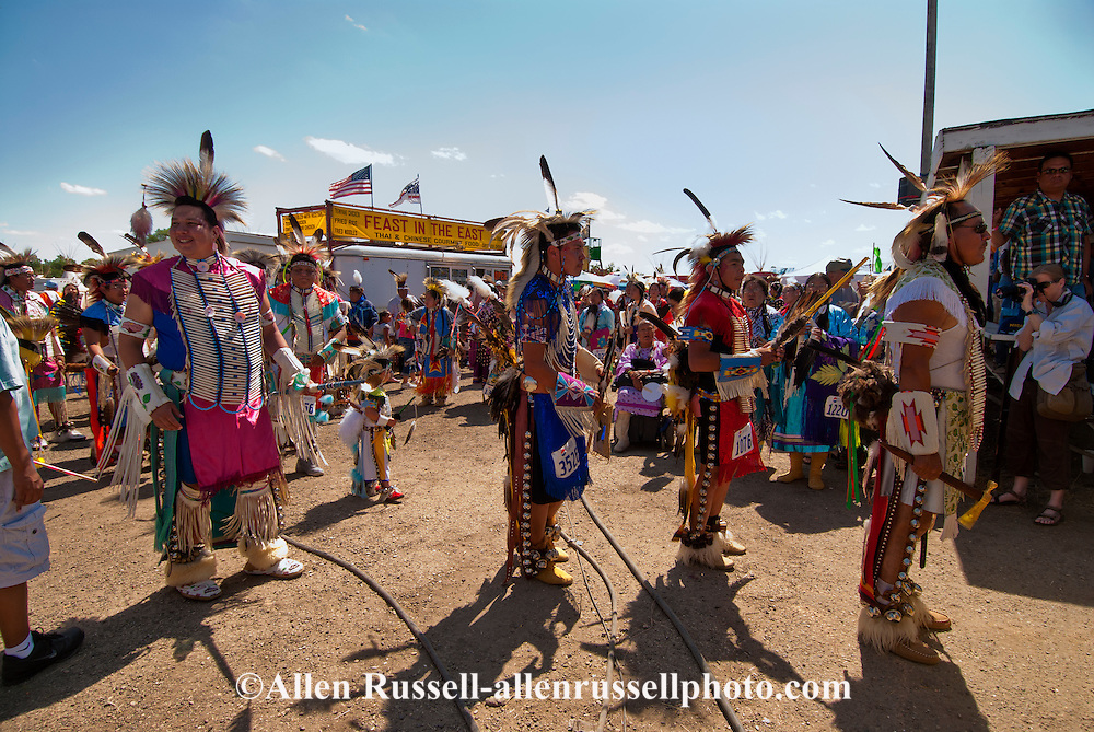 Traditional dancers,  enter Grand Entry, Crow Fair powwow, Crow Indian Reservation, Montana.