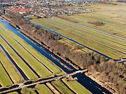 Nederland, Zuid-Holland, Gemeente Ouderkerk, 20-02-2012; Krimpenerwaard met Stolwijksche Boezem. De boezem is in het verleden gebruikt voor tijdelijke opvang van het polderwater. De langwerpige verkaveling is ontstaan door het ontginnen van het veen vanuit de dorpen langs de rivier de Hollandsche IJssel. .Polder Kattendijksblok (voorgrond) heeft ontginningen met vrije opstreek, de sloten en de Vliet zorgen voor ontwatering. In de achtergrond Gouderak aan de Hollandsche IJssel, Moordrecht aan de andere zijde van de rivier.Krimpenerwaard with Stolwijk boezem, the 'bosom' was used in the past for temporary storage of polder water. The land division (in lots) is the result of the reclamation of peat bog that started from the villages along the river Hollandsche IJssel. The ditches and brook provide drainage..luchtfoto (toeslag), aerial photo (additional fee required);.copyright foto/photo Siebe Swart.