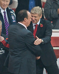 LONDON, ENGLAND - Wednesday, October 28, 2009: Liverpool's manager Rafael Benitez and Arsenal's manager Arsene Wenger during the League Cup 4th Round match at Emirates Stadium. (Photo by David Rawcliffe/Propaganda)