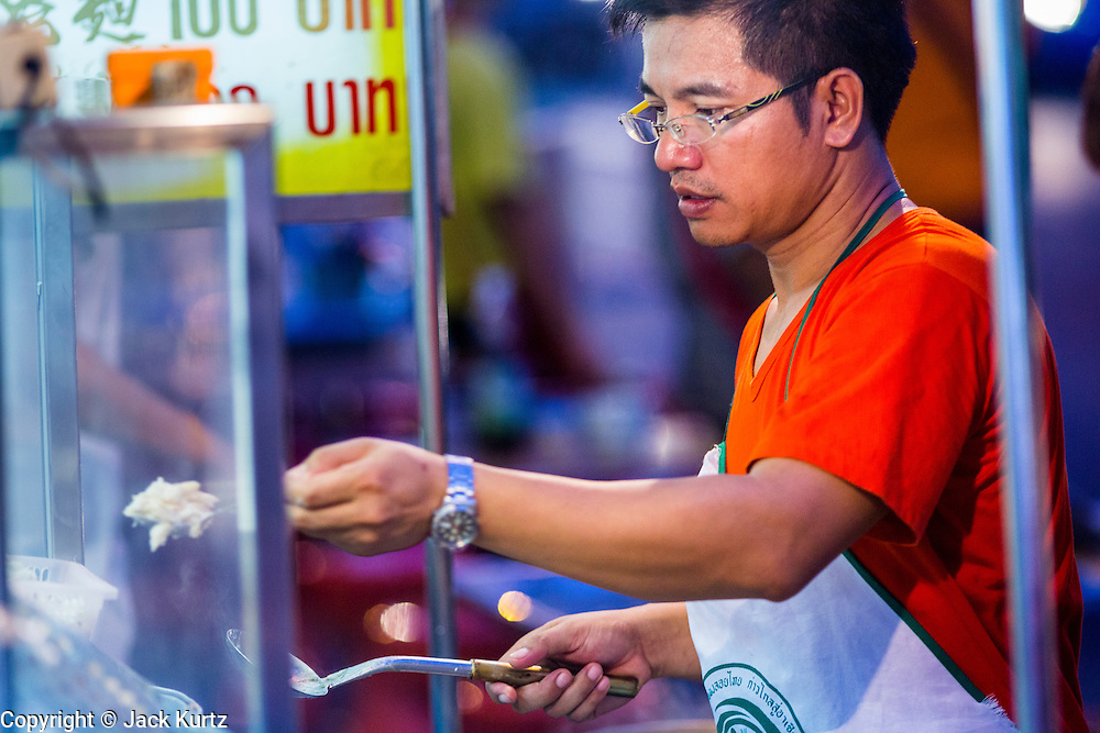 11 SEPTEMBER 2013 - BANGKOK, THAILAND:  A man prepares dumplings in his street food stall in the Chinatown section of Bangkok. Thailand in general, and Bangkok in particular, has a vibrant tradition of street food and eating on the run. In recent years, Bangkok's street food has become something of an international landmark and is being written about in glossy travel magazines and in the pages of the New York Times.        PHOTO BY JACK KURTZ