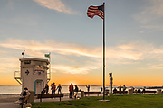 Locals Enjoying the Sunset at Main Beach Lifeguard Tower in Laguna Beach