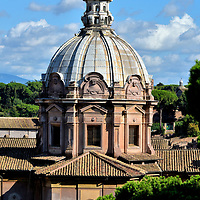 Dome of Santi Luca e Martina in Rome, Italy<br /> After Saint Martina was brutally martyred in 228 for refusing to forsake her Christianity, she became the patron saint of Rome. The original church dedicated to her was built overlooking the Roman Forum during the 7th century. Nearly 1,000 years later, Baroque painter Pietro da Cortona championed the church's reconstruction. During his excavation work in 1634, he claimed to have uncovered the relics of Saint Martina. Shown here is the hemispherical dome. The upper drum is constructed from travertine limestone. Since 1589, the Catholic church has also honored San Luca (Saint Luke) when it was gifted to a society of artists named Accademia di San Luca.