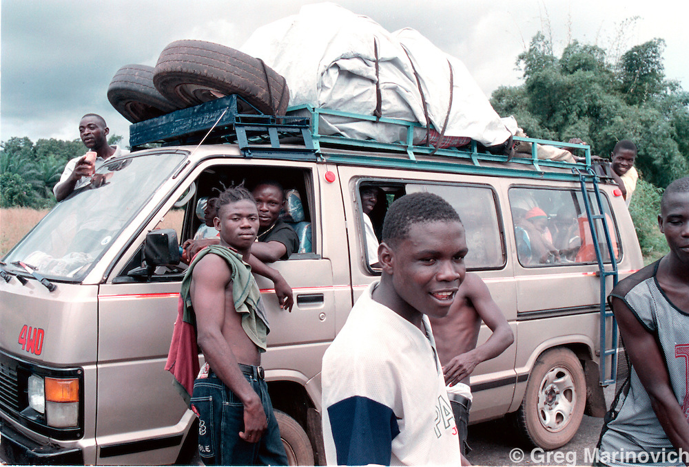 IPMG0912 Bo Waterfront, Liberia. Soldier loyal to Sekouh Conneh Jr's LURD rebels man a roadblock on the road between Monrovia and the border crossing with Sierra leone at Bo Waterfront, Sept 22, 2003. Liberia's decades long civil conflict has destabilised the entire region and turned a generation of youth into fighters.  Greg Marinovich/South Photographs