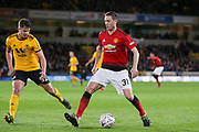 Manchester United Midfielder Nemanja Matic battles with Wolverhampton Wanderers midfielder Leander Dendoncker (32) during the The FA Cup match between Wolverhampton Wanderers and Manchester United at Molineux, Wolverhampton, England on 16 March 2019.