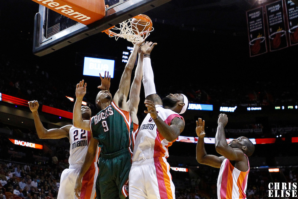 22 January 2012: Milwaukee Bucks point guard Shaun Livingston (9) vies for the rebound with Miami Heat small forward LeBron James (6) and Miami Heat small forward James Jones (22) during the Milwaukee Bucks 91-82 victory over the Miami Heat at the AmericanAirlines Arena, Miami, Florida, USA.