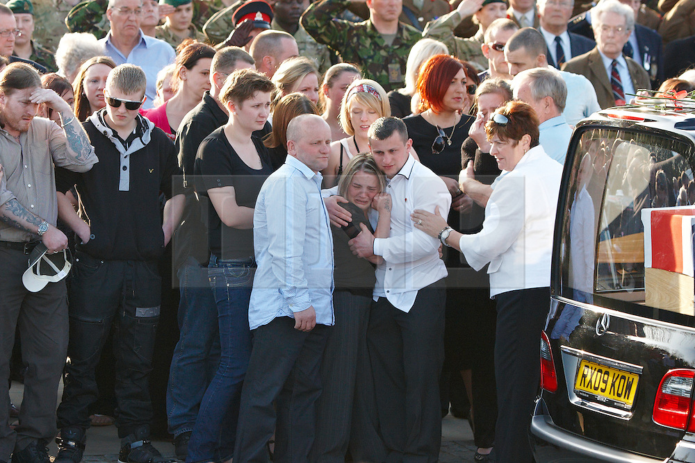 © Licensed to London News Pictures.  29/03/2012. CARTERTON, UK. Friends and family pay their respects during the repatriation ceremony for Capt Rupert Bowers (2nd Battalion, The Mercian Regiment), L/Cpl Michael Foley (Adjutant General's Corps) and Sgt Luke Taylor (Royal Marines).  Photo credit:  Cliff Hide/LNP