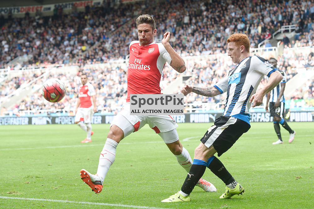 Olivier Giroud (left) and Jack Colback (right) in the Newcastle United v Arsenal Barclays Premier League match at St James' Park Newcastle 09 August 2015<br /> <br /> (c) Greg Macvean / SportPix.org.uk