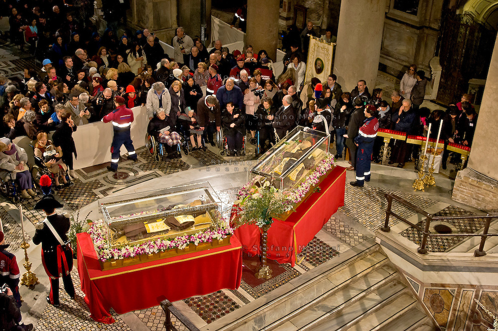 Rome, Italy. 3th Febraury 2016<br /> The relic of St. Pio of Pietrelcina and the relic of St. Leopold Mandic in the Basilica of San Lorenzo Fuori le mura. The St. Pio of Pietrelcina were called to Rome by Pope Francis as symbol of the Mercy Jubilee..