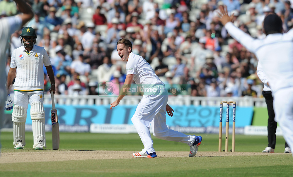 England's Chris Woakes celebrates after trapping Pakistan's Asad Shafiq lbw during day five of the 3rd Investec Test Match at Edgbaston, Birmingham.