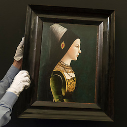 "© Licensed to London News Pictures. 29/06/2018. LONDON, UK. A staff member presents ""Portrait of Mary of Burgundy in Profile"" by Netherlandish or South German School, late 15th century (Est. £1-1.5m).  Preview of Old Masters, British, Treasures, Sculptures and Ancient works at Sotheby's New Bond Street to be offered for sale on 3 and 4 July 2018.  Photo credit: Stephen Chung/LNP"