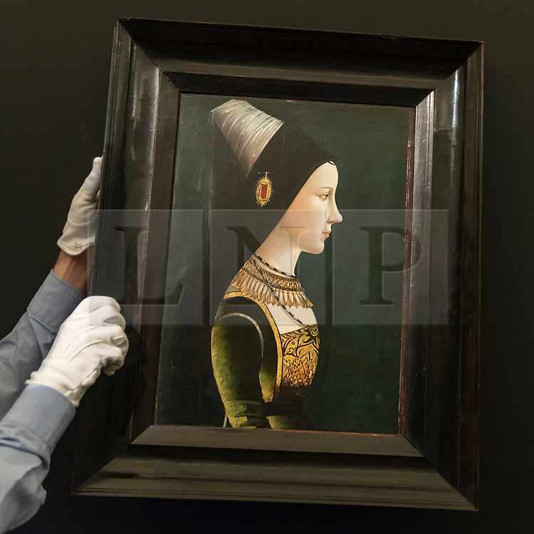 """© Licensed to London News Pictures. 29/06/2018. LONDON, UK. A staff member presents """"Portrait of Mary of Burgundy in Profile"""" by Netherlandish or South German School, late 15th century (Est. £1-1.5m).  Preview of Old Masters, British, Treasures, Sculptures and Ancient works at Sotheby's New Bond Street to be offered for sale on 3 and 4 July 2018.  Photo credit: Stephen Chung/LNP"""