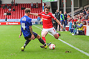 Walsall's Andy Taylor attempts to put in a cross during the Sky Bet League 1 match between Walsall and Bury at the Banks's Stadium, Walsall, England on 5 September 2015. Photo by Shane Healey.