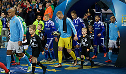 MANCHESTER, ENGLAND - Tuesday, March 15, 2016: Manchester City's goalkeeper Joe Hart walks out with a mascot before in the UEFA Champions League Round of 16 2nd Leg match against FC Dynamo Kyiv at the City of Manchester Stadium. (Pic by David Rawcliffe/Propaganda)