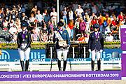 Podium Grade IV 1. Sanne Voets - Demantur RS2 N.O.P., 2. Manon Claeys - San Dior, 3. Louise Etzner Jakobsson - Zernard<br /> FEI European Championships 2019<br /> © DigiShots