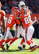 Arizona Cardinals tight end Jermaine Gresham (84) catches a first quarter pass for a gain of 6 yards and a first down at the Cleveland Browns 16 yard line as he gets gang tackled from all sides by Cleveland Browns inside linebacker Karlos Dansby (56), Cleveland Browns defensive tackle Xavier Cooper (96), and another Browns teammate during the 2015 week 8 regular season NFL football game against the Arizona Cardinals on Sunday, Nov. 1, 2015 in Cleveland. The Cardinals won the game 34-20. (©Paul Anthony Spinelli)
