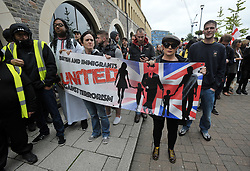"""© Licensed to London News Pictures.  10/09/2017; Bristol, UK. A group called British and Immigrants United Against Terrorism joins forces with another group called Gays Against Sharia to stage a demonstration in Bristol city centre. A counter-protest was also held called 'Stand Up To Racism and Bigotry'. A statement issued to oppose the march says that the demonstrators """"claim falsely that they are representing the views of the LGBT+ community in Bristol,"""" adding: """"In fact, none of the organisers are LGBT+ and all the proposed speakers come from outside Bristol."""" A heavy police presence Police with riot vans dogs and horses were in attendance. Police banned face coverings, masks, banners and flags 'that might incite hatred' ahead of today's protests. Picture credit : Simon Chapman/LNP"""