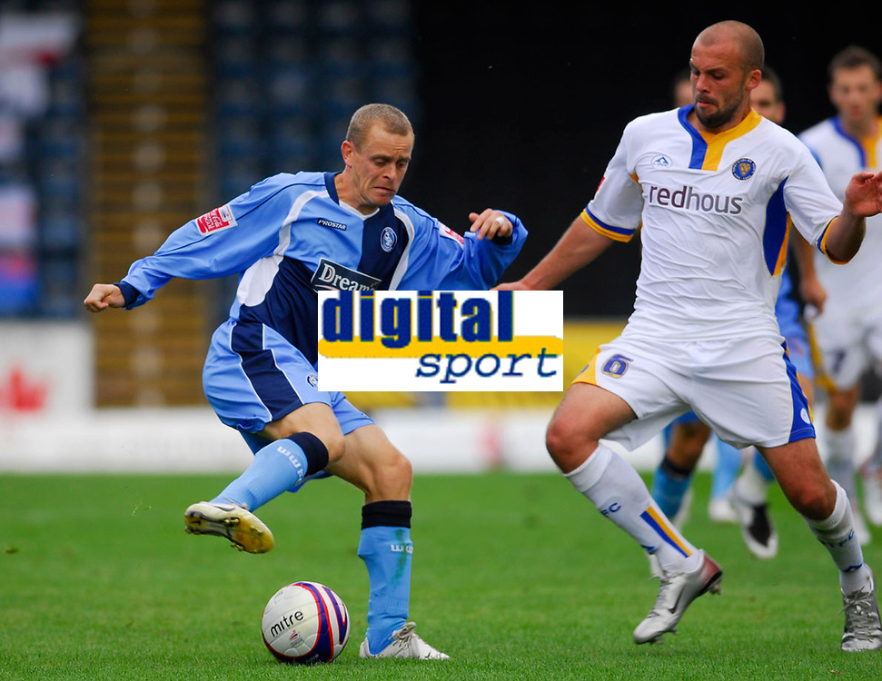 Photo: Leigh Quinnell.<br /> Wycombe Wanderers v Shrewsbury. Coca Cola League 2. 22/09/2007. Wycombes Martin Bullock pulls the ball away from Shrewsburys David Hunt.