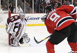 Mar 15; Newark, NJ, USA; New Jersey Devils left wing Zach Parise (9) takes a shot on Colorado Avalanche goalie Jean-Sebastien Giguere (35) during the second period at the Prudential Center.