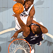 Utah Jazz guard Ronnie Brewer (9) scores over Memphis Grizzlies forward Sam Young (4) as the Utah Jazz  take a 120-93 win over the Memphis Grizzlies in the EnergySolutions Arena in Salt Lake City, Utah, Monday, Nov. 30, 2009. August Miller, Deseret News .