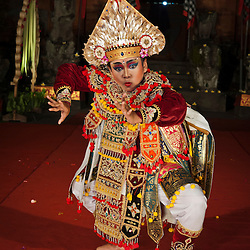 Balinese dancer performing the dance of the warrior in Padangtegal temple, Ubud, Bali, Indonesia