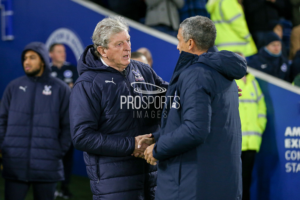Brighton and Hove Albion manager Chris Hughton greets Crystal Palace Manager Roy Hodgson during the Premier League match between Brighton and Hove Albion and Crystal Palace at the American Express Community Stadium, Brighton and Hove, England on 4 December 2018.