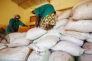 Women pile sacks of dried shea nuts in a storage room at the Si Yiriwa shea processing center in the town of Diolila, Mali on Friday January 15, 2010.