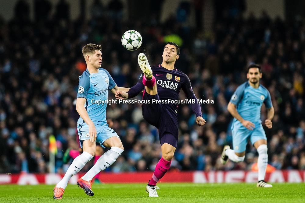 2016.11.01 Manchester<br /> Pilka nozna Liga Mistrzow sezon 2016/2017<br /> Manchester City - FC Barcelona<br /> N/z John Stones Luis Suarez<br /> Foto Sebastian Frej / PressFocus<br /> <br /> 2016.11.01 Manchester<br /> Football Champions League season 2016/2017<br /> Manchester City - FC Barcelona<br /> John Stones Luis Suarez<br /> Credit: Sebastian Frej / PressFocus