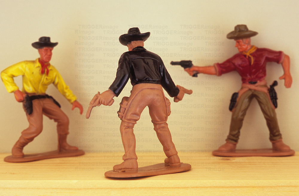 Three model cowboys in shootout