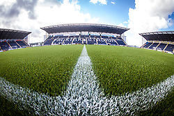 The three stands from the half-way line with the new plastic pitch. The Falkirk Stadium, for the Scottish Championship game v Morton. The woven GreenFields MX synthetic turf and the surface has been specifically designed for football with 50mm tufts compared with the longer 65mm which has been used for mixed football and rugby uses.  It is fully FFA two star compliant and conforms to rules laid out by the SPL and SFL.<br /> &copy;Michael Schofield.