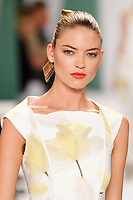 Martha Hunt walks the runway wearing Carolina Herrera Spring 2015 during Mecedes-Benz Fashion Week in New York on September 8th, 2014