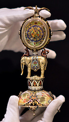 © Licensed to London News Pictures. 10/01/2013. London, USA. A finely enamelled Vienna Silver miniature clock with exotic animals and hidden enamel inside c1850, 8,000GBP. The Mayfair The opening day of The Mayfair Antiques & Fine Art Fair. Items on offer include a selection of antiques and works of art, ranging from period furniture, sculpture, oriental artefacts, silver, clocks, calling card cases, objects of vertu and boxes to paintings, ceramics, glass, jewellery, books, oriental carpets, textiles, prints and decorative items. The fair continues until January 13. Photo credit : Stephen Simpson/LNP