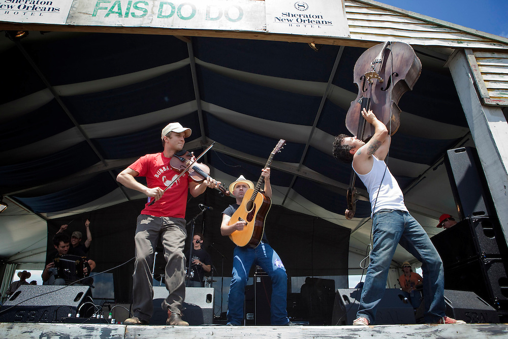 Cajun fiddle and singer Louis Michot, guitarist Cavan Carruth and upright bassist Alan Lafleur of the Lost Bayou Ramblers performing Cajun music on the Fais Do-Do Stage at the New Orleans Jazz and Heritage Festival at the New Orleans Fair Grounds Race Course in New Orleans, Louisiana, USA, 24 April 2009.