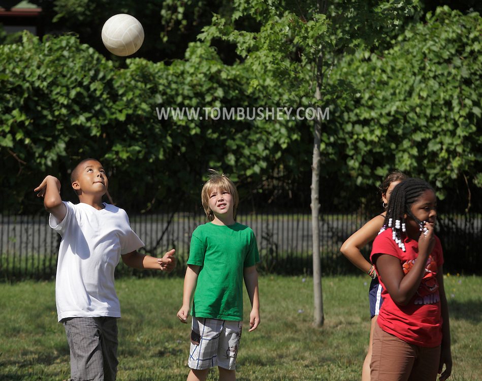 Middletown, New York - A boy serves the ball during a volleyball during a game at the Middletown YMCA summer camp on August 20, 2010.