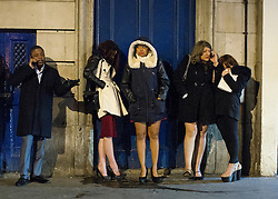 © Licensed to London News Pictures. 20/12/2014. Revellers queue for a taxi in central London as they celebrated the start of the Christmas holidays. The last Friday before Christmas is also known as Mad Friday, which is one of the busiest nights of the year with millions descending into bars and pubs for some festive fun. Photo credit : Isabel Infantes / LNP