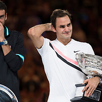 Roger Federer of Switzerland and Marin Cilic of Croatia during the trophy presentation after the 2018 Australian Open on day 14 at Rod Laver Arena in Melbourne, Australia on Sunday afternoon January 28, 2018.<br /> (Ben Solomon/Tennis Australia)