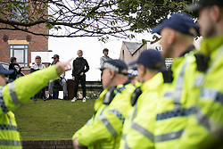 © Licensed to London News Pictures . 29/07/2017 . Rochdale , UK . Local youths look on as far-right street protest movement , the English Defence League ( EDL ) , hold a demonstration in Rochdale , opposed by anti-fascists , including Unite Against Fascism ( UAF ) . The EDL say they are demonstrating against the sexual grooming and abuse of English girls by Muslim men in Rochdale and against terrorism across the UK . Photo credit : Joel Goodman/LNP